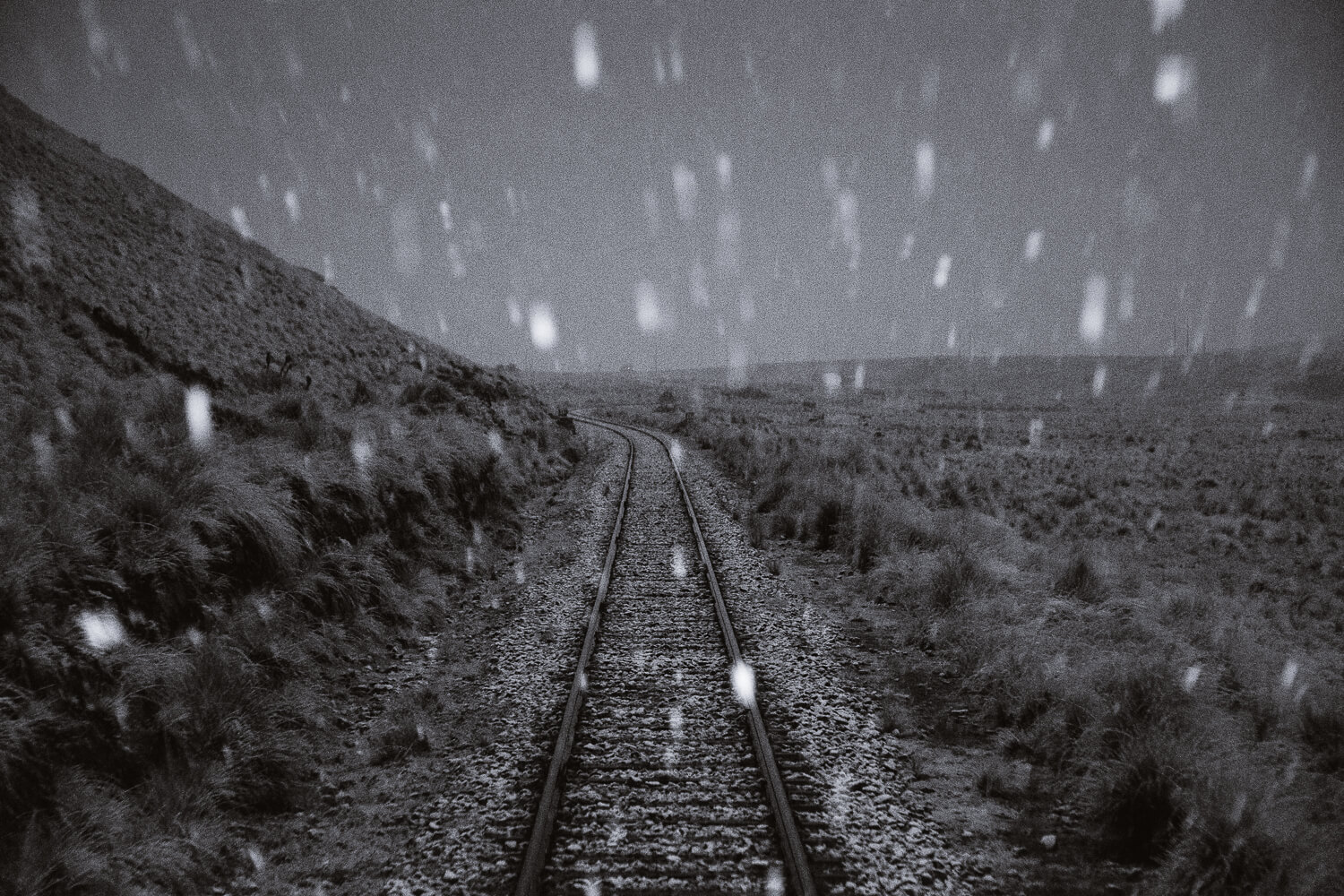 """A blizzard in the Andes on the Belmond Andean Explorer. Travel photography and guide by © Natasha Lequepeys for """"And Then I Met Yoko"""". #peru #sacredvalley #cusco #laketiticaca #belmondandeanexplorer #perurail #perutrain #luxurytravel #sleepertrain #photoblog #travelblog #travelphotography #fujifilm #andes #travel #travelperu #cuscotolaketiticaca #spiritofthelake #belmond #puno #southamerica"""