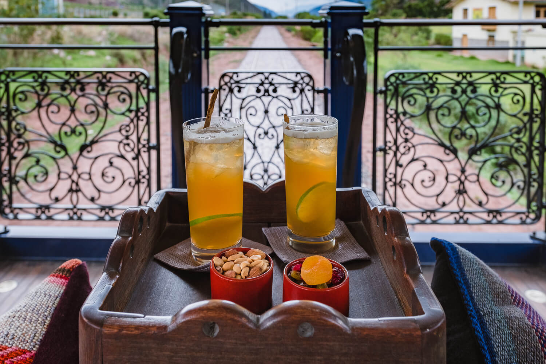 "Cocktails at the back of the train. Travel photography and guide by © Natasha Lequepeys for ""And Then I Met Yoko"". #peru #sacredvalley #cusco #laketiticaca #belmondandeanexplorer #perurail #perutrain #luxurytravel #sleepertrain #photoblog #travelblog #travelphotography #fujifilm #andes #travel #travelperu #cuscotolaketiticaca #spiritofthelake #belmond #puno #southamerica"