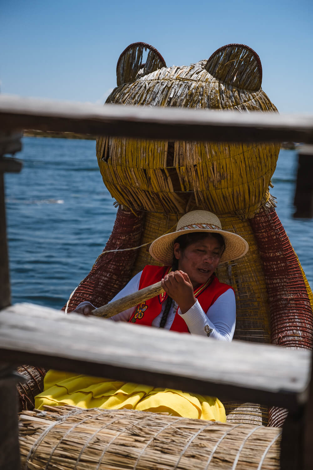 """Woman from Uros Island rowing the reed boat. Travel photography and guide by © Natasha Lequepeys for """"And Then I Met Yoko"""". #peru #laketiticaca #amantani #taquile #homestay #culturalexperience #photoblog #travelblog #travelphotography #fujifilm #travel #travelperu #southamerica #allwaystravel #laketiticacaitinerary #puno #uros #floatingislands #pachamama #pachatata"""