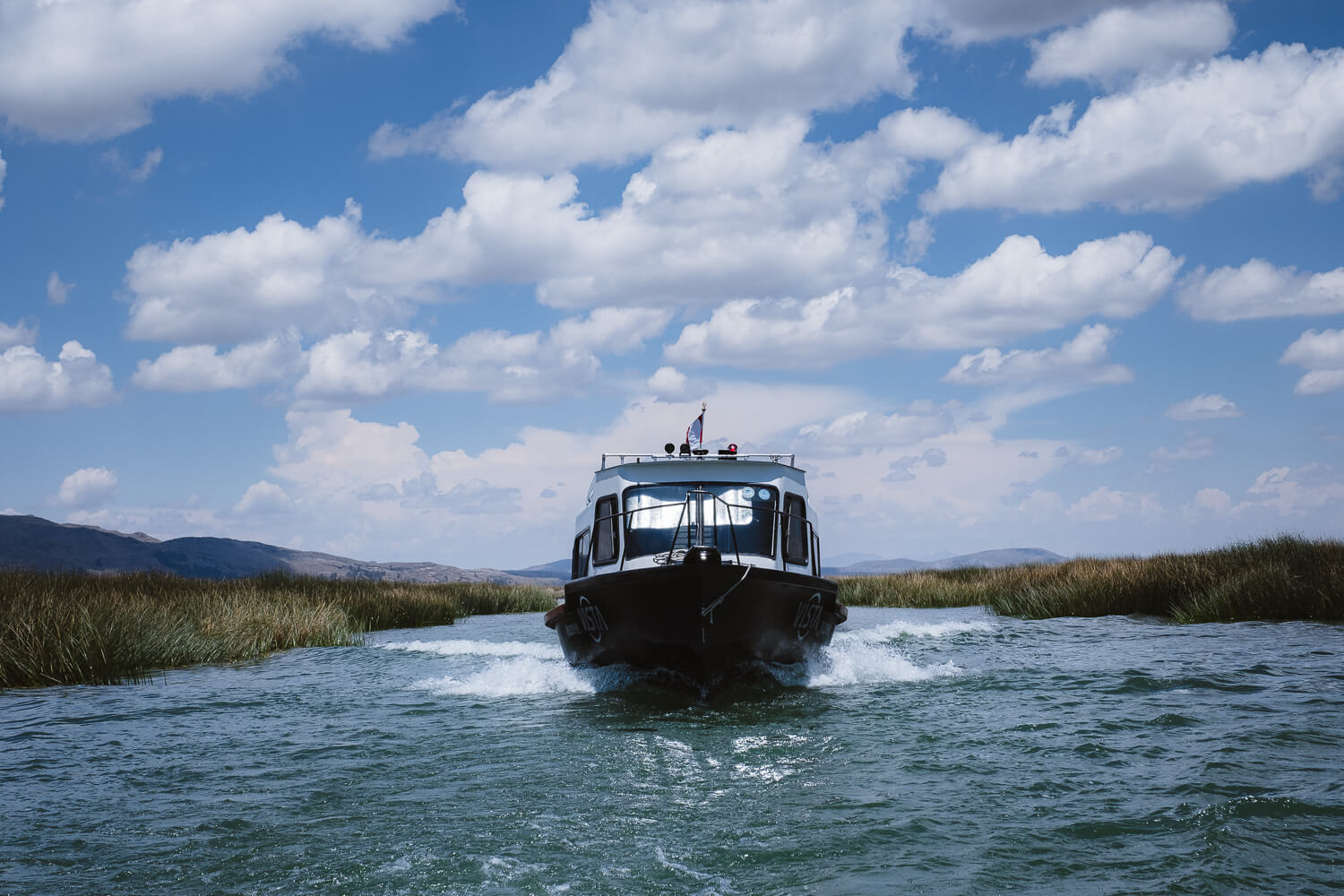 """High-speed boats headed to the islands. Travel photography and guide by © Natasha Lequepeys for """"And Then I Met Yoko"""". #peru #laketiticaca #amantani #taquile #homestay #culturalexperience #photoblog #travelblog #travelphotography #fujifilm #travel #travelperu #southamerica #allwaystravel #laketiticacaitinerary #puno #uros #floatingislands #pachamama #pachatata"""