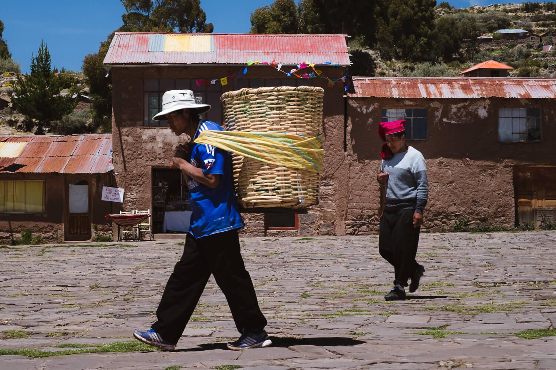 "Men working in main square, Taquile Island. Travel photography and guide by © Natasha Lequepeys for ""And Then I Met Yoko"". #peru #laketiticaca #amantani #taquile #homestay #culturalexperience #photoblog #travelblog #travelphotography #fujifilm #travel #travelperu #southamerica #allwaystravel #laketiticacaitinerary #puno #uros #floatingislands #pachamama #pachatata"