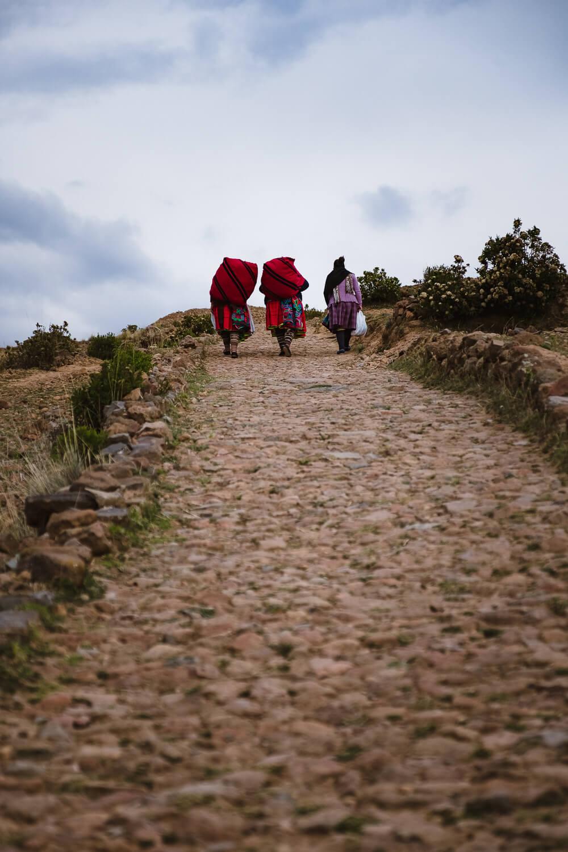 "Women with their merchandise, Amantani Island. Travel photography and guide by © Natasha Lequepeys for ""And Then I Met Yoko"". #peru #laketiticaca #homestay #photoblog #travelblog #fujifilm"