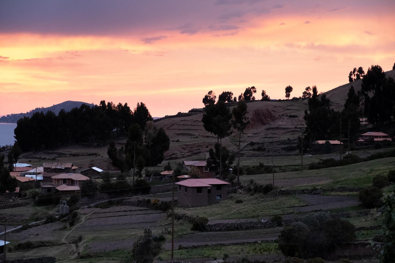 "Sunset on Amantani Island. Travel photography and guide by © Natasha Lequepeys for ""And Then I Met Yoko"". #peru #laketiticaca #homestay #photoblog #travelblog #fujifilm"