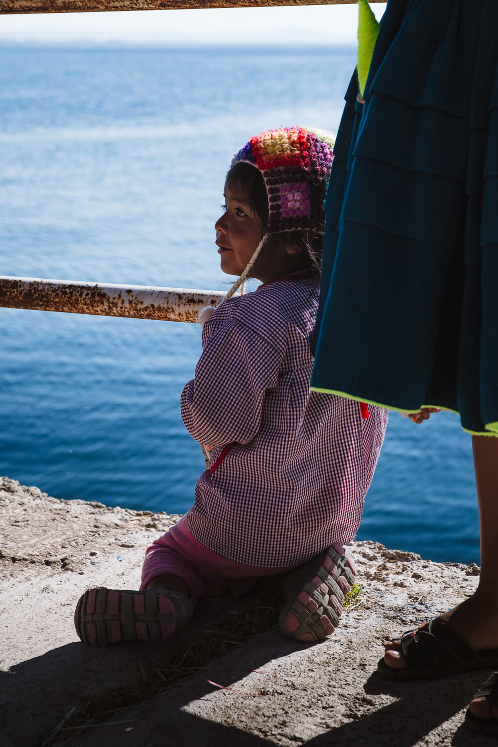 """A little girl from a homestay family, Amantani Island. Travel photography and guide by © Natasha Lequepeys for """"And Then I Met Yoko"""". #peru #laketiticaca #homestay #photoblog #travelblog #fujifilm"""