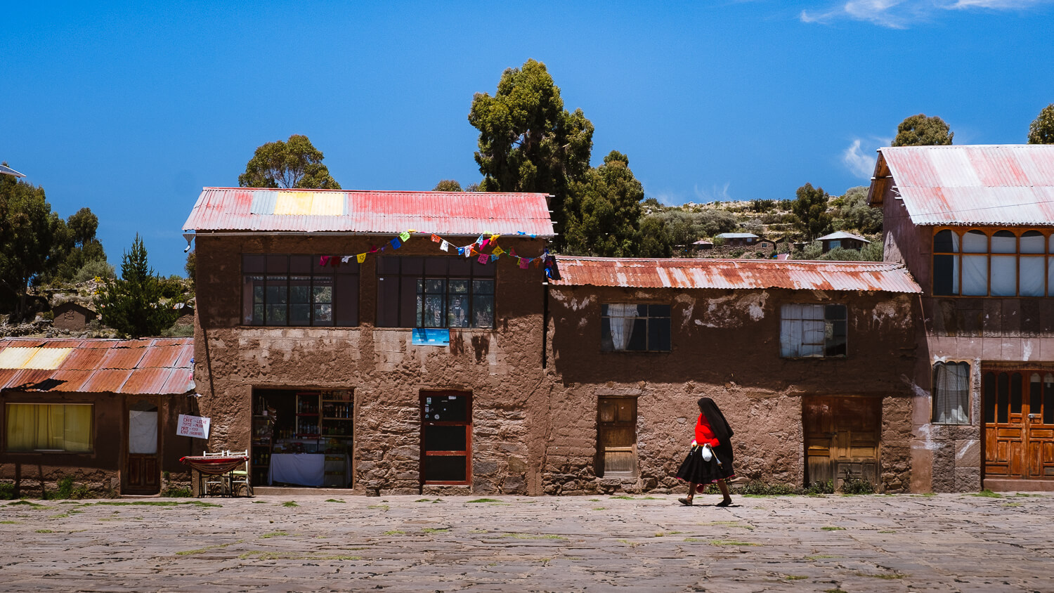 """A woman in the main square, Taquile Island. Travel photography and guide by © Natasha Lequepeys for """"And Then I Met Yoko"""". #peru #laketiticaca #homestay #photoblog #travelblog #fujifilm"""