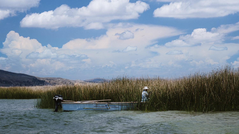 "Locals in their boat, near Puno. Travel photography and guide by © Natasha Lequepeys for ""And Then I Met Yoko"". #peru #laketiticaca #amantani #taquile #homestay #culturalexperience #photoblog #travelblog #travelphotography #fujifilm #travel #travelperu #southamerica #allwaystravel #laketiticacaitinerary #puno #uros #floatingislands #pachamama #pachatata"