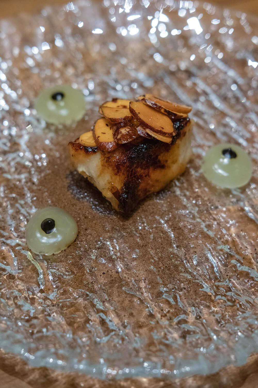 Gindara Misoyaki - Cod marinated in miso, crispy Bahuaja nuts, apple gel, Porcon mushroom powder