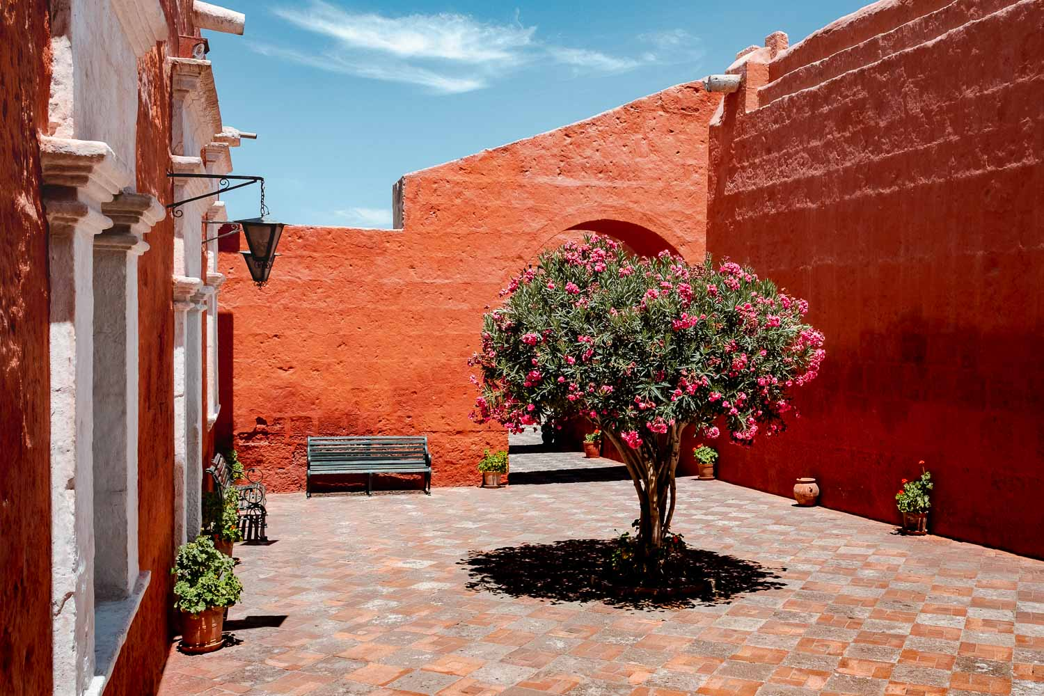 """A red courtyard in the Santa Catalina Monastery, Arequipa, Peru. Travel photography and guide by © Natasha Lequepeys for """"And Then I Met Yoko"""". #peru #photoblog #fujifilm"""