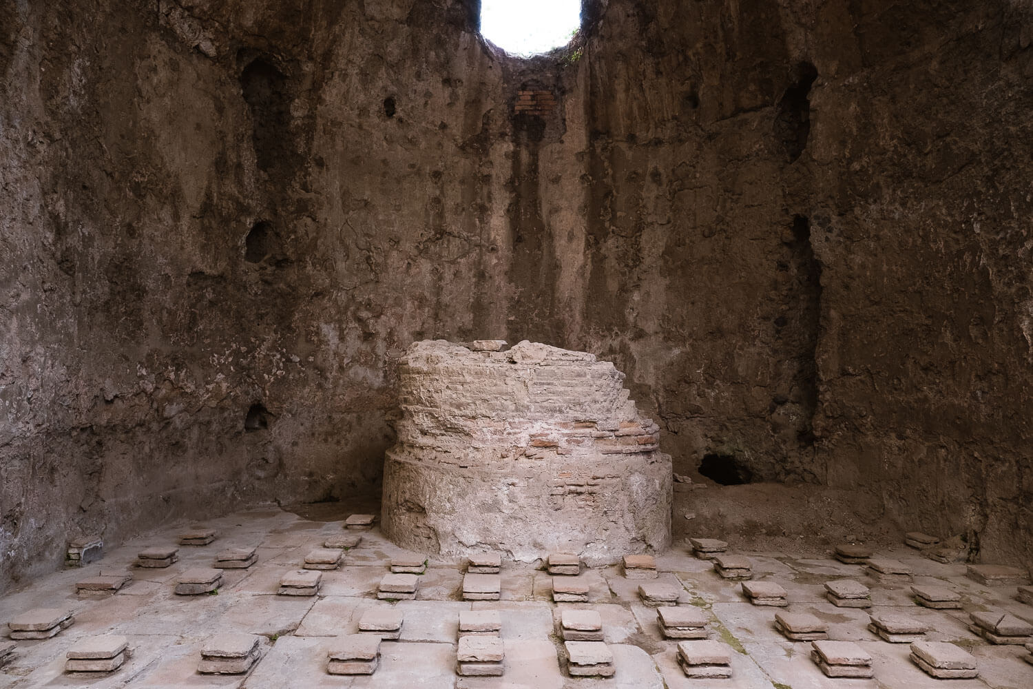 """Tiles on the floor showing the hypocaust system in the thermal baths, Pompeii. Travel photography and guide by © Natasha Lequepeys for """"And Then I Met Yoko"""". #pompeii #italy #fujifilm #travelphotography"""
