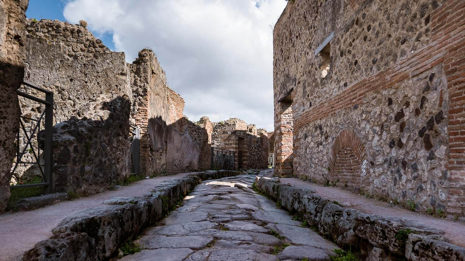"""The one curved road in Pompeii. Travel photography and guide by © Natasha Lequepeys for """"And Then I Met Yoko"""". #pompeii #italy #fujifilm #travelphotography"""
