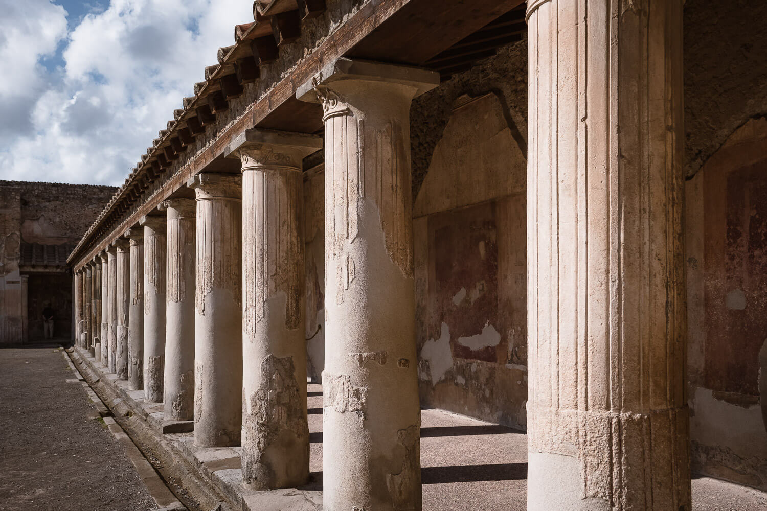 """Pillars casting a shadow, Pompeii, Italy. Travel photography and guide by © Natasha Lequepeys for """"And Then I Met Yoko"""". #pompeii #italy #fujifilm #travelphotography"""