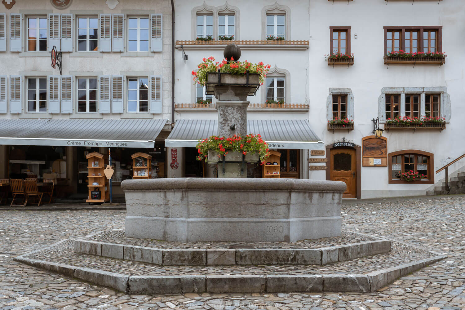 "The fountain in Gruyères, Switzerland. Travel photography and guide by © Natasha Lequepeys for ""And Then I Met Yoko"". #gruyere #switzerland #travelguide #travelphotography"