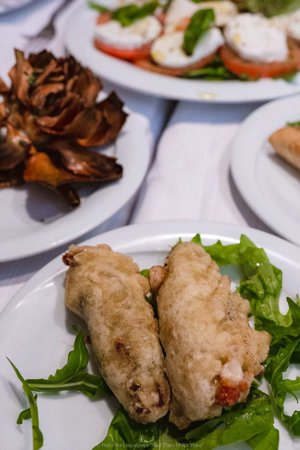 """Fried zucchini blossoms in the Jewish Ghetto, Rome. Travel photography and guide by © Natasha Lequepeys for """"And Then I Met Yoko"""". #rome #jewishghettorome #italy #fujifilm #travelphotography"""