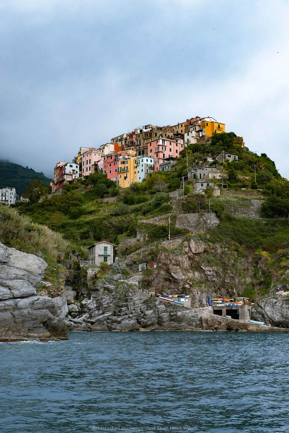 """Corniglia from the water, Cinque Terre. Travel photography and guide by © Natasha Lequepeys for """"And Then I Met Yoko"""". #cinqueterre #italy #travelphotography"""