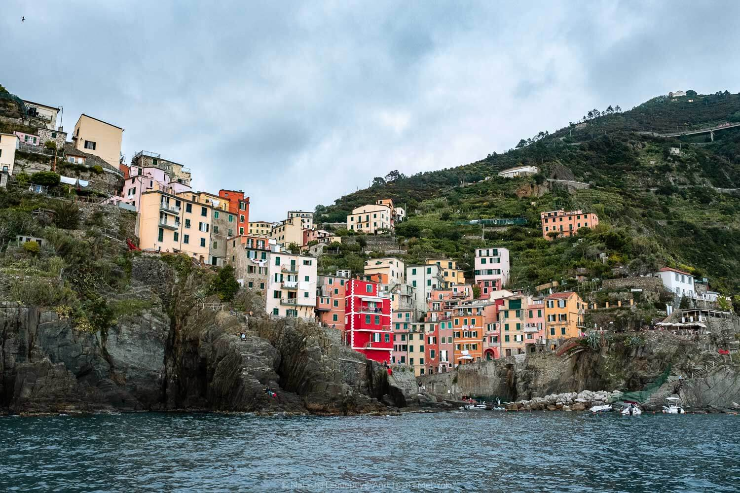 """Riomaggiore from the water, Cinque Terre. Travel photography and guide by © Natasha Lequepeys for """"And Then I Met Yoko"""". #cinqueterre #italy #travelphotography"""