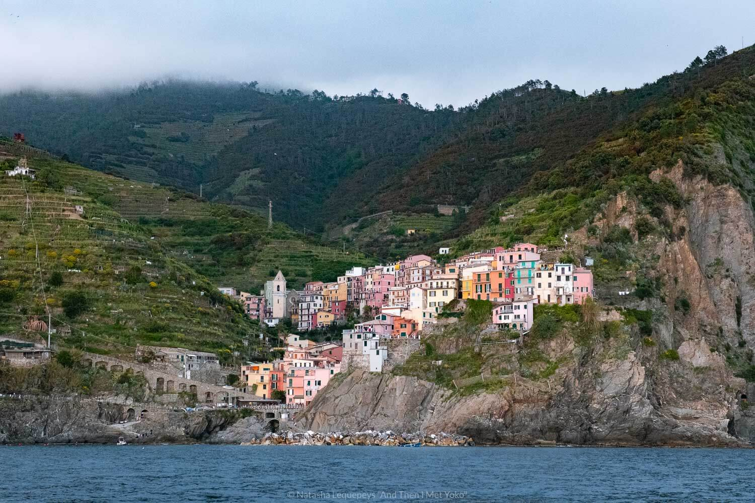 """Manarola from the water, Cinque Terre. Travel photography and guide by © Natasha Lequepeys for """"And Then I Met Yoko"""". #cinqueterre #italy #travelphotography"""