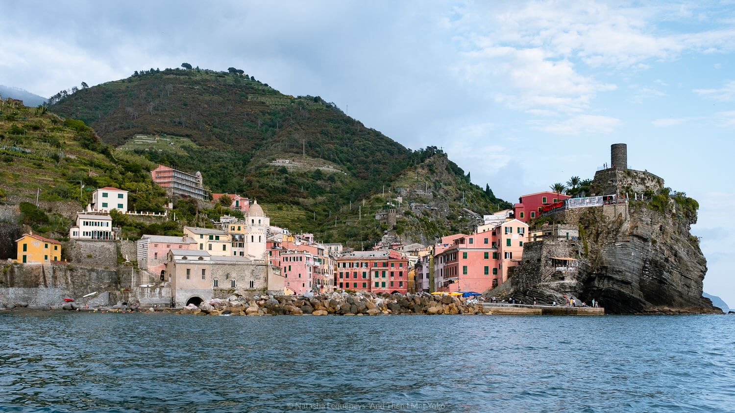 """Vernazza from the water in Cinque Terre. Travel photography and guide by © Natasha Lequepeys for """"And Then I Met Yoko"""". #cinqueterre #italy #travelphotography"""