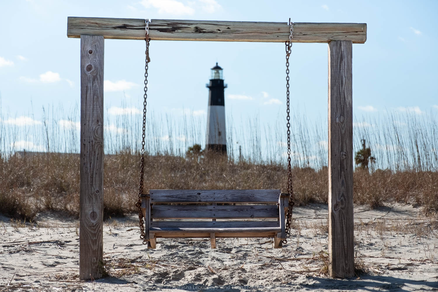 """A wooden bench on the beach in Tybee Island - Savannah, Georgia. Travel photography and guide by © Natasha Lequepeys for """"And Then I Met Yoko"""". #savannah #usa #travelguide #travelblog"""