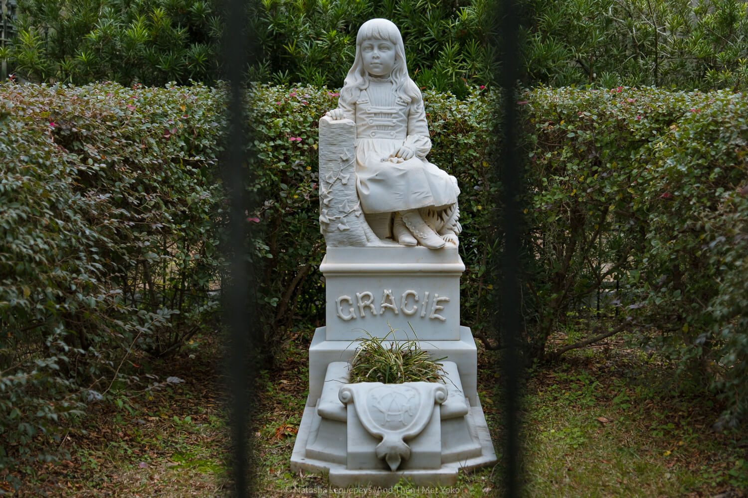 """Little Gracie grave site at Bonaventure Cemetery in Savannah, Georgia. Travel photography and guide by © Natasha Lequepeys for """"And Then I Met Yoko"""". #bonaventurecemetery #savannah #travelguide #travelblog #travelphotography #fujifilm"""