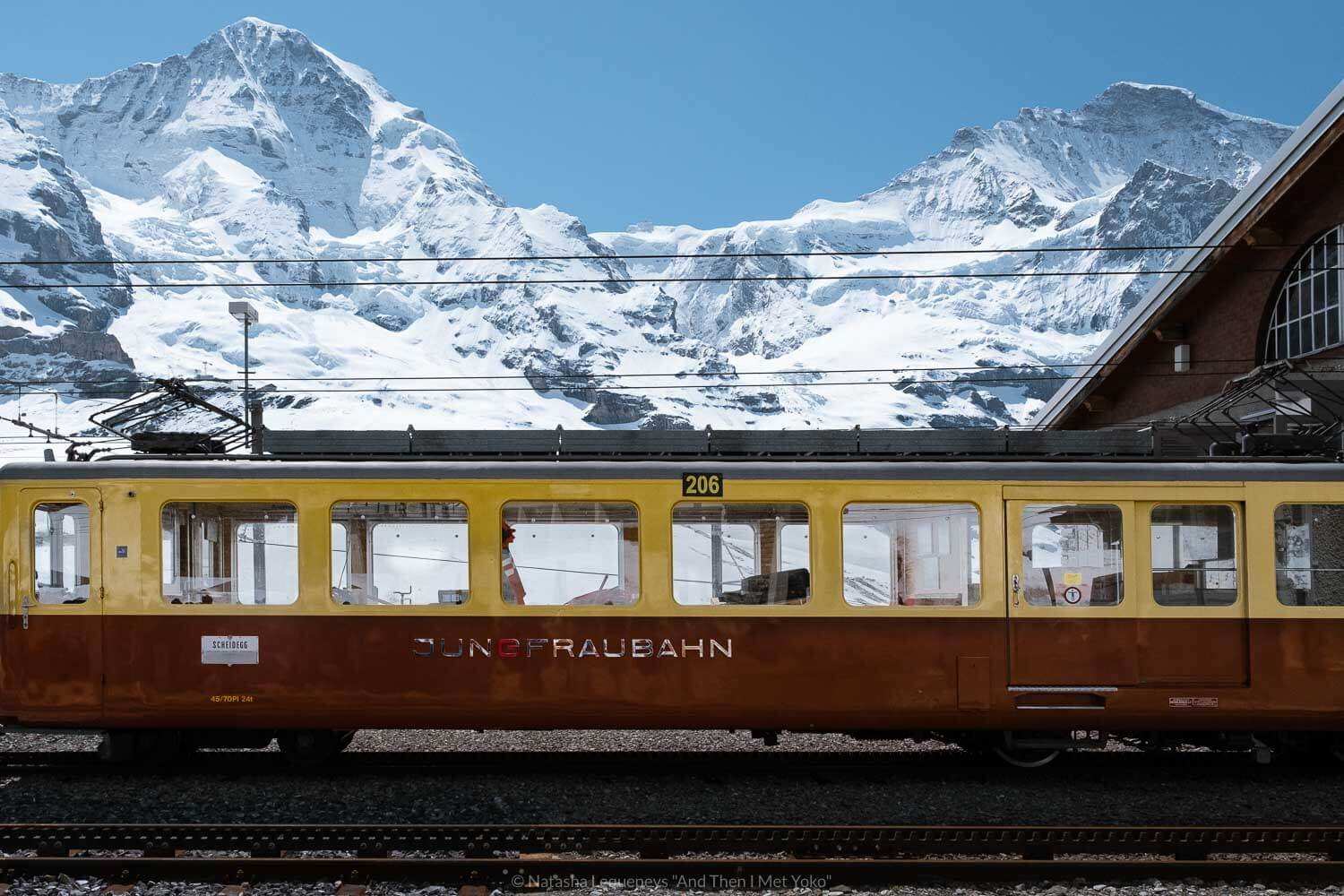 "The Jungfraubahn train that runs from Kleine Scheidegg to Jungfraujoch. Travel photography and guide by © Natasha Lequepeys for ""And Then I Met Yoko"". #wengen #jungfraujoch #travelguide #switzerland #travelphotography"