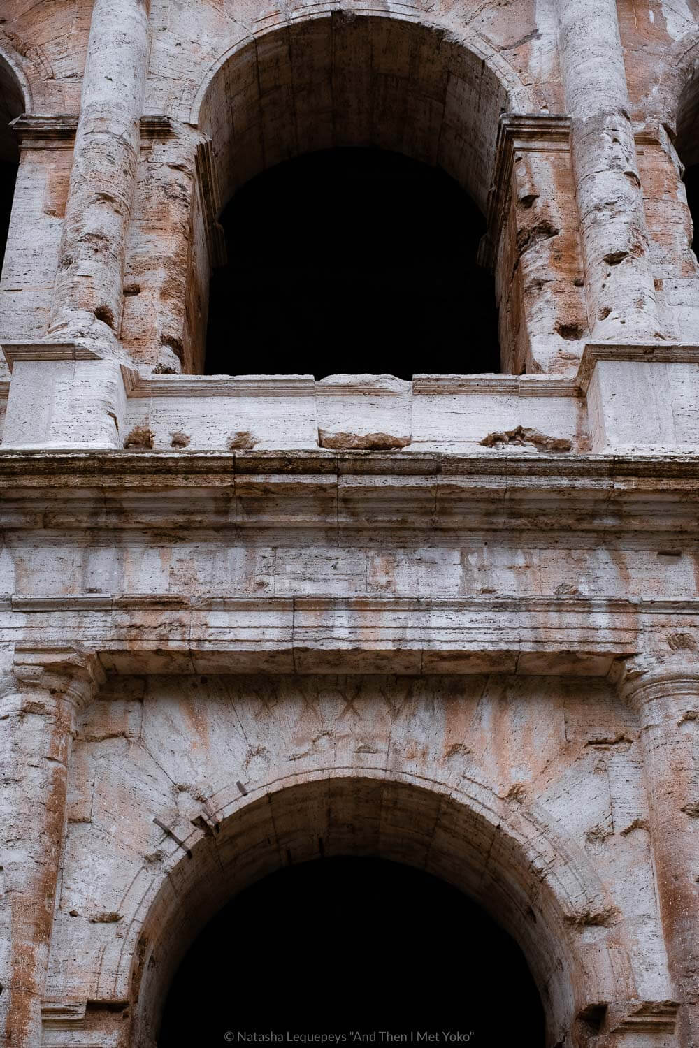 """Arches in the Colosseum in Rome, Italy. Travel photography and guide by © Natasha Lequepeys for """"And Then I Met Yoko"""". #rome #italy #travelblog #travelphotography"""