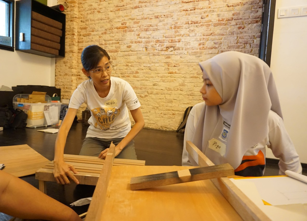 In groups of four, the students were tasked with crafting a bed tray each to be used at an old folks' home in Penang. The facilitators guided the students through the design thinking process of creating a product using a few samples.