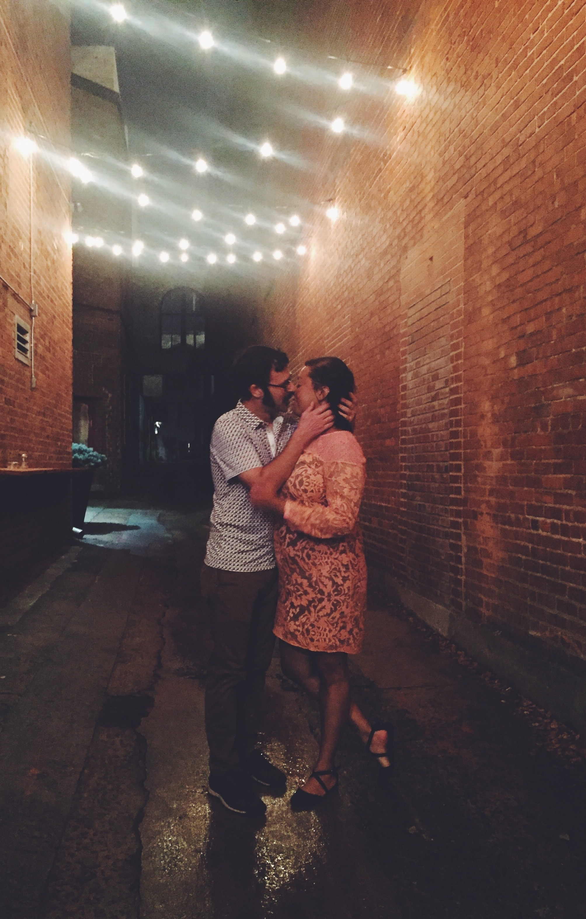 """HOW WE MET - Brian and I circled each other for years. He likely served me coffee at Caffé Driade when I was in undergrad, we lived within half a mile of each other in Chapel Hill, and shopped at the same grocery store.In 2015 I started going to yoga at The Durham Hotel, thanks to Jessica Collette of La Vita Yoga. I had sworn off setting foot in the hotel for various reasons, but the prospect of $10 yoga was too good. So I went and sporadically ate breakfast in the coffee shop downstairs, using the big open space to write in my journal and chuckling at being in a fancy hotel in sweaty, holey yoga outfits.In September of 2016 I was re-entering my practice after a very painful year, both emotionally and physically. I had stopped into the hotel for a tea after a slow day of work in my office. Brian, the barista whom I always found nice (and now suddenly seemed very attractive) offered me a second steep. It wasn't out of the ordinary, because everyone there is always kind, and because I had """"SWORN OFF DATING FOREVER."""" Yes, I'm a cliché. He added me on facebook that evening. I noticed our mutual friends were folks dear to me, that he loved karaoke, and yes, he was very attractive. Still, I didn't think much of it.Emboldened by goddess knows what (likely the burst of energy I get from celebrating Halloween), I began to flirt with Brian, drinking my beverages right at the bar instead of across the coffeeshop. I found him funny, kind and smart, and very unlike the mediocre men who were taking up too much of my time and all of my emotional labor. I found a way to get him to ask me out: I told him I was going to check out Discotoño play a set at Arcana. Brian took my """"in,"""" and offered to join me.Hours before this meeting I went to a friend's house to help another friend carve her first pumpkin. I take my responsibilities as Queen of Halloween very seriously, so I was running pretty late to Arcana. I messaged Brian to say that I was half an hour behind, not because I was tryin"""