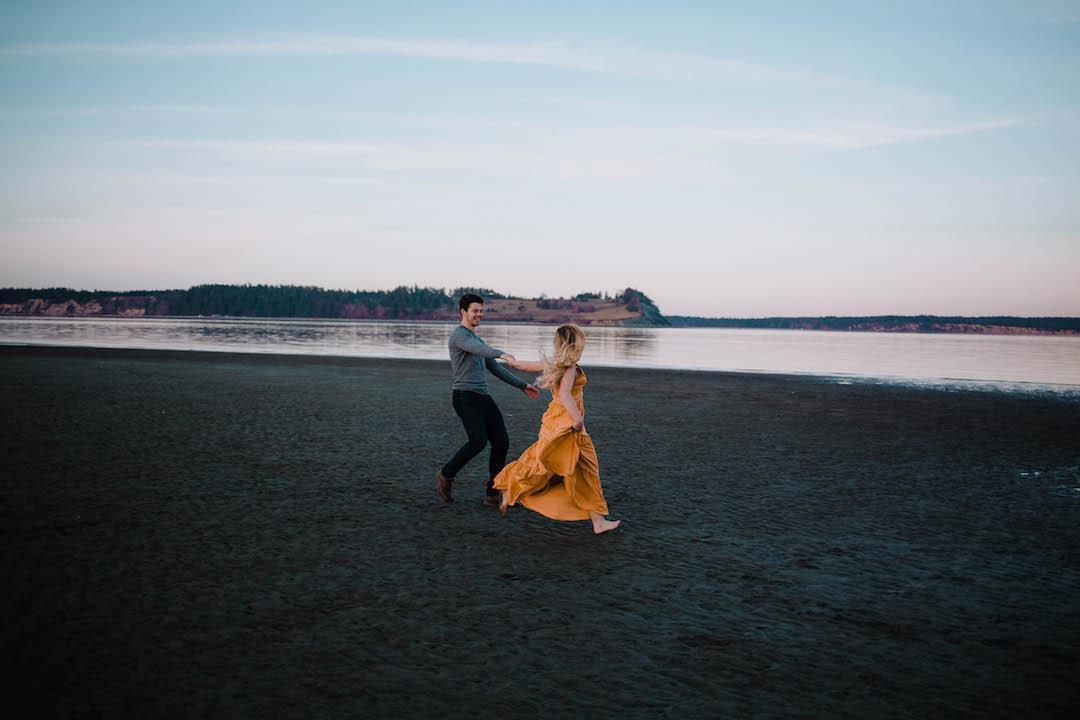 Couple-wild-and-free-on-black-sand-beach-west-coast.jpg