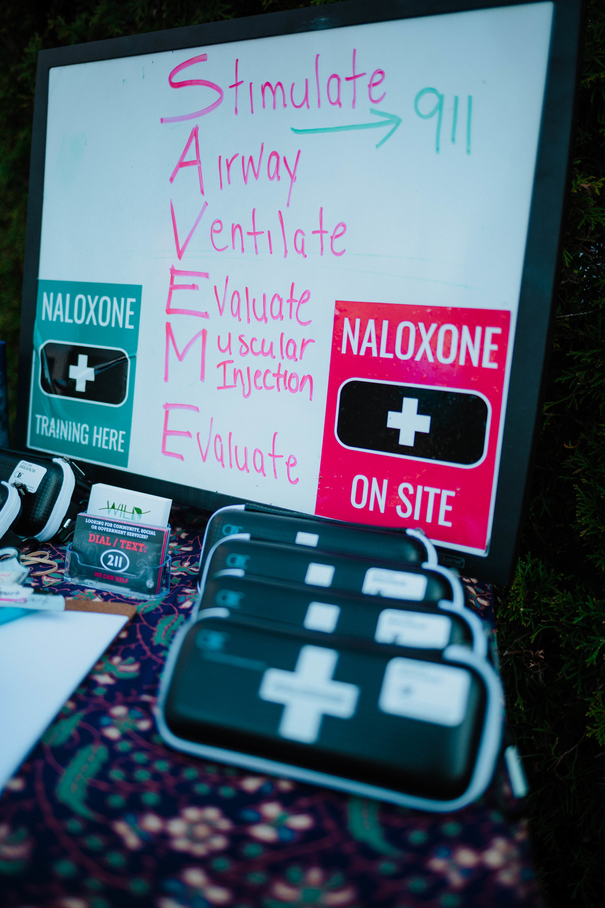 WILD trains all of their employees, volunteers and peers who are wanting to equip themselves, with how to use a naloxone kit. Naloxone is a medication used to block the effects of opioids, especially in overdose and when trained, everyone is capable of admitting.