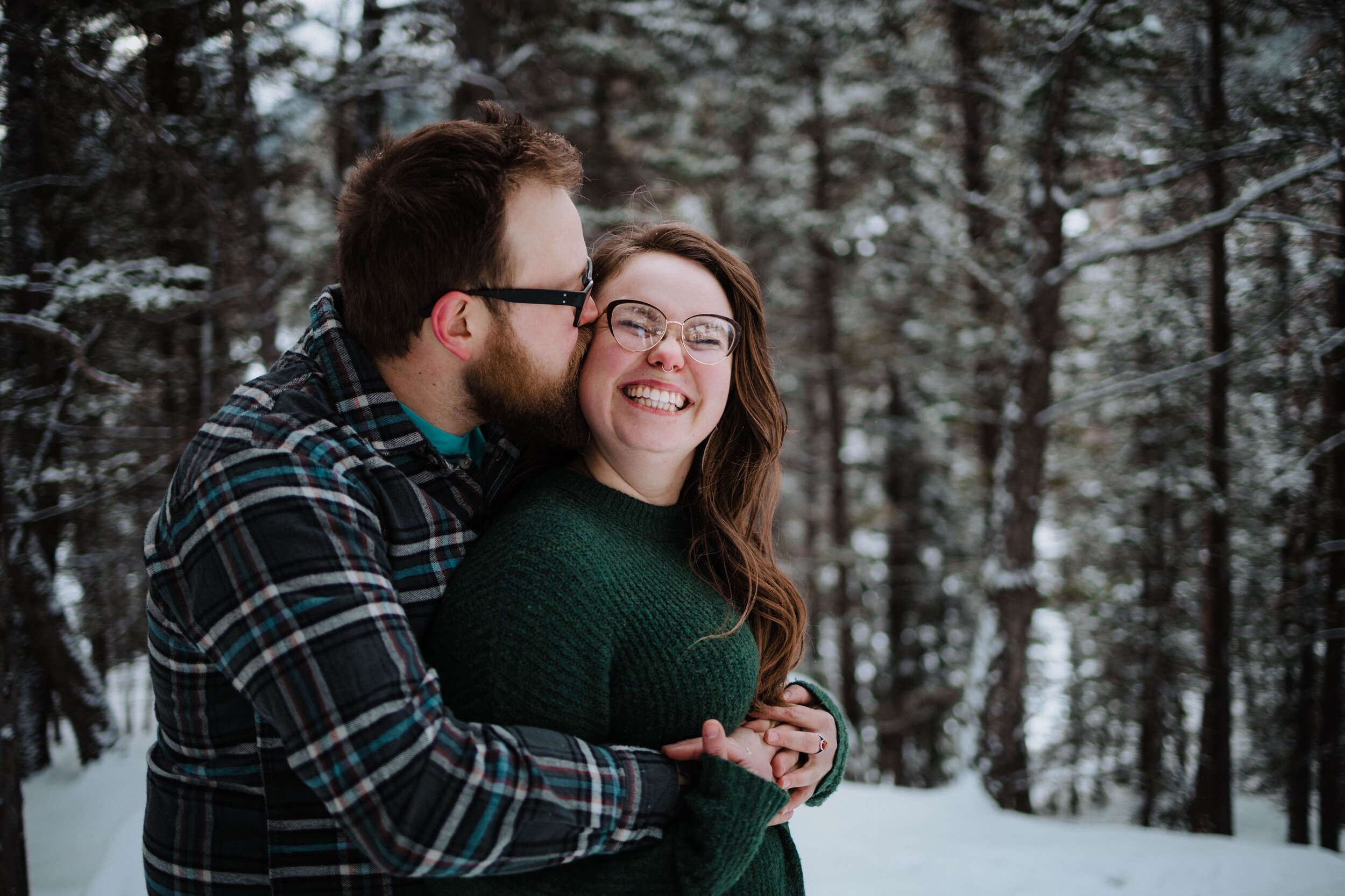 Couple snuggling in Banff National Park