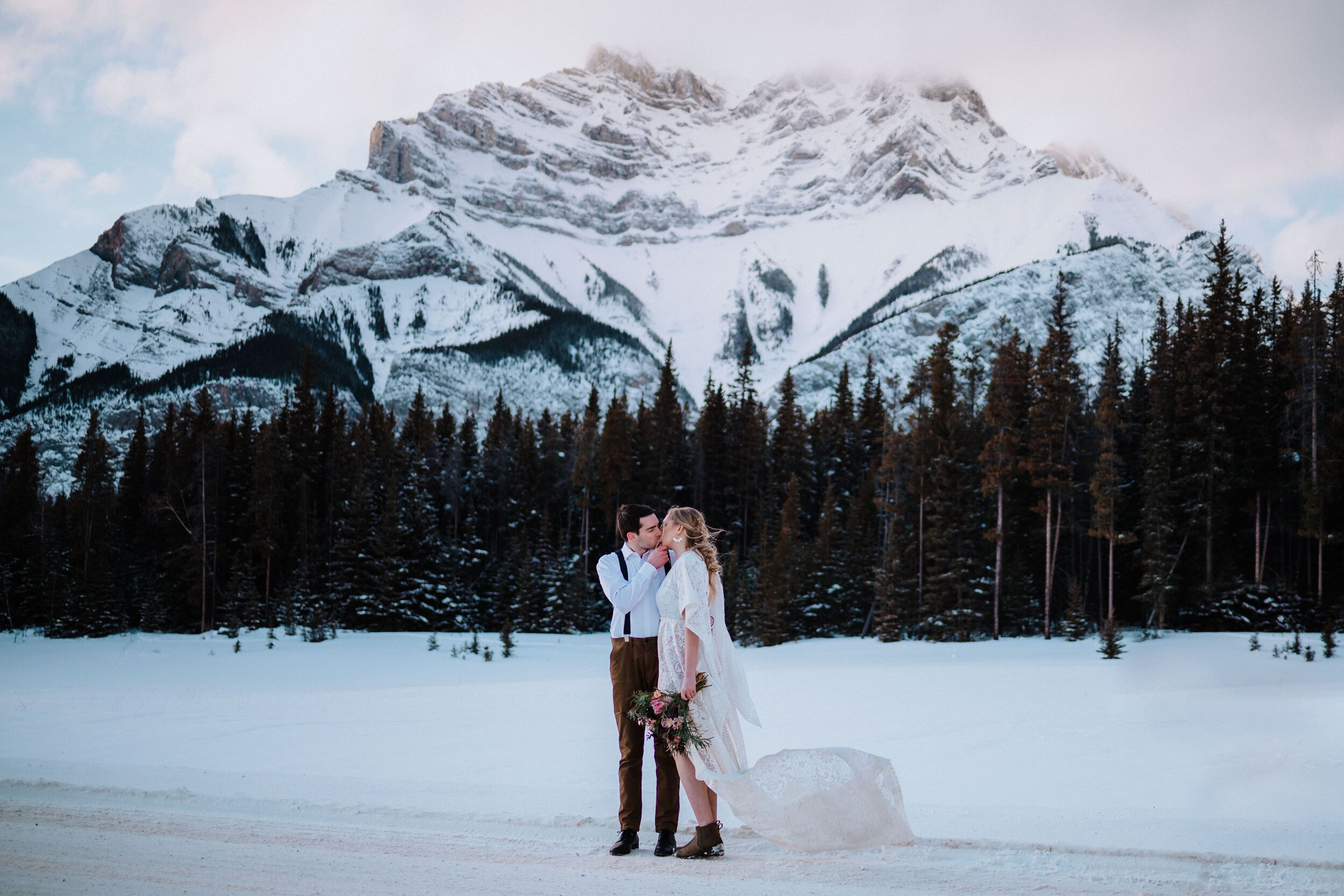 Small elopement at Lake Minnewanka Banff Alberta. Megan Maundrell Photography shares a few photos from this stunning intimate elopement.