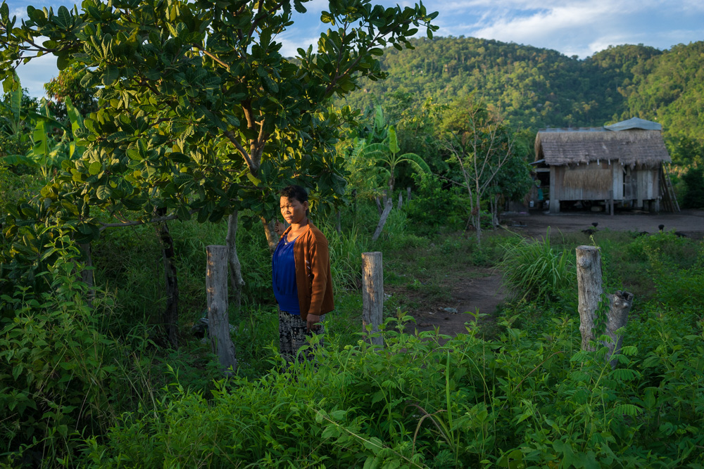 August 20, 2015 - Pis Village - Omlaing (Cambodia). Ms. Pheun Ra (40) in front of her house. In 2010 she was evicted and forced to move with her family in the resettlement village and was given a small plot of land (40x50m) to farm. © Thomas Cristofoletti / Ruom for OXFAM Australia