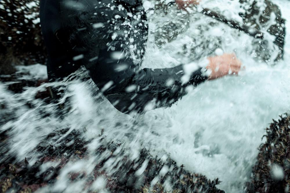 December 20, 2011 - Laxe (La Coruña). A percebeiro gets hit by an unexpected wave. © Thomas Cristofoletti 2011