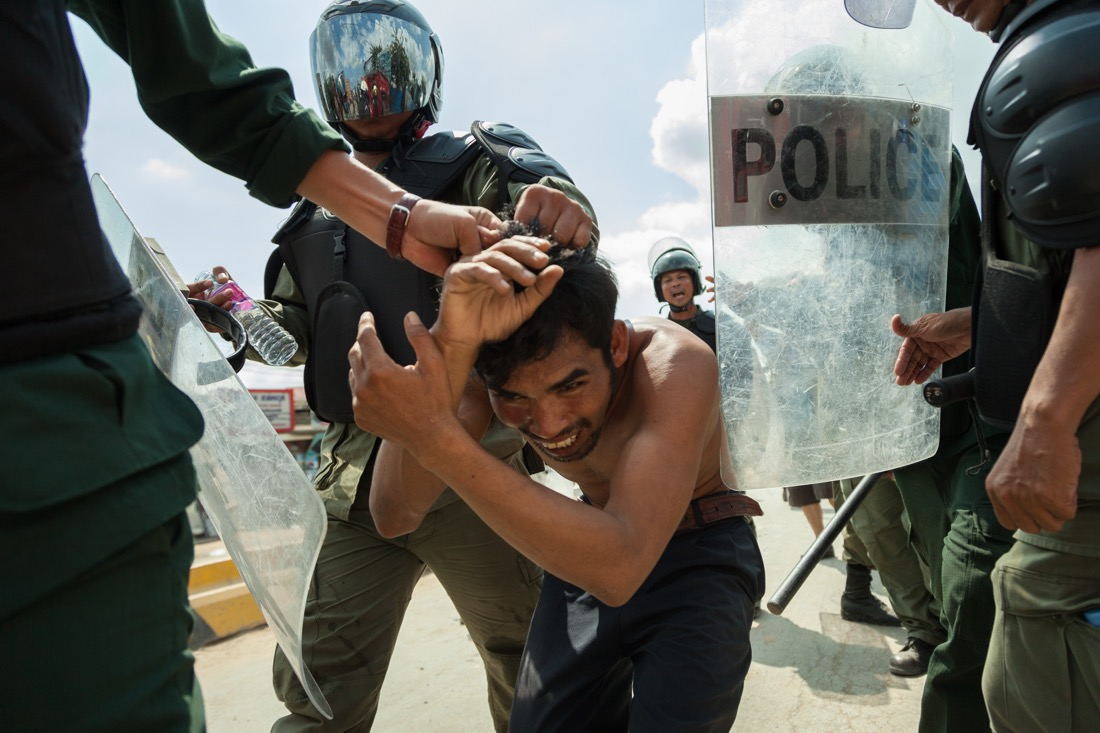 November 12, 2013 - Phnom Penh. Cambodian anti-riot police arrest a protester during a clash between police and garment workers. One woman was shot dead and several injured in the violent clashes. © Thomas Cristofoletti / Ruom