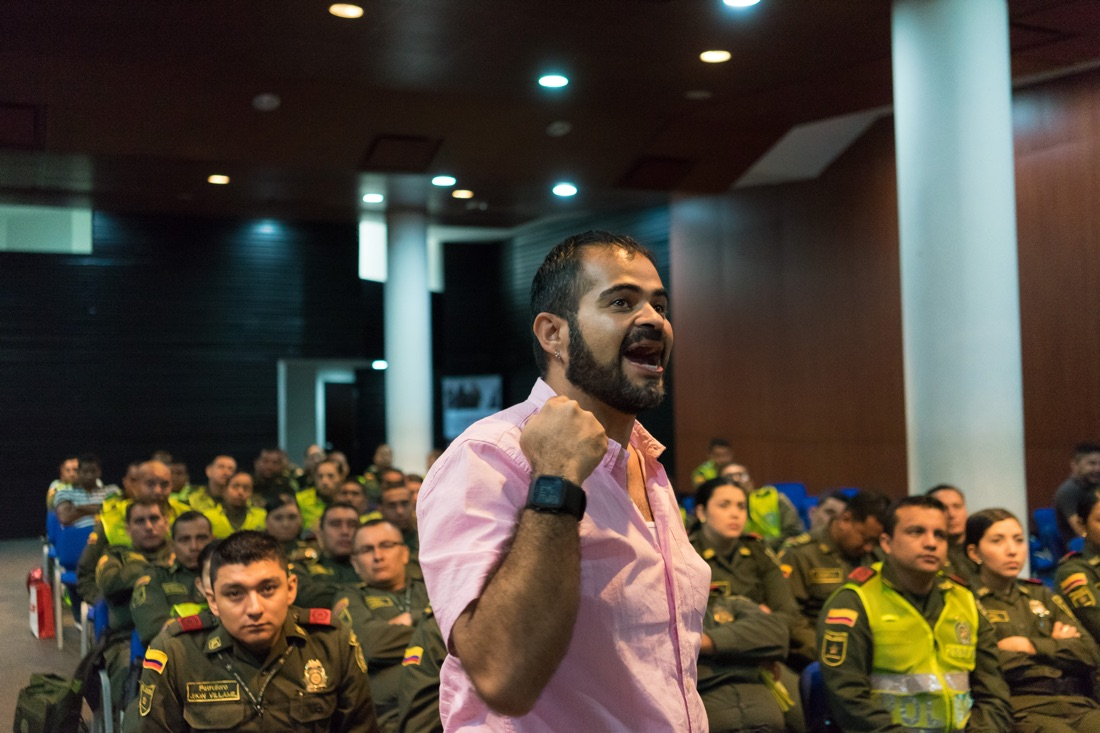"CARTAGENA, COLOMBIA - FEBRUARY 25, 2015: Wilson Castañeda, the director of the LGBT rights group Caribe Afirmativo, trains police officers in the city of Cartagena, on Colombia's Caribbean coast. With support from USAID, Caribe Afirmativo works with many sectors of society to try to improve the well-being of members of the LGBT community, including improving their relationship with police. ""In our first human rights report in 2007, we discovered something very troubling,"" says Castañeda. ""And that was that the people who committed the most violence against the LGBT population in Colombia's Caribbean region were the police."" In Cartagena, where prostitution is legal and sexual tourism is common, altercations between police and sex workers would often turn violent, with the trans population the most affected by the violence. As part of its advocacy efforts, Caribe Afirmativo works with the local police, giving trainings on sexual and gender diversity and the rights of the LGBT community. Caribe Afirmativo was founded in 2007 after the murder of the college professor and LGBT rights activist Rolando Peréz. The group documents cases of abuse against the LGBT population, trains law enforcement and policy officials on human rights, and advocates against impunity for those who commit crimes against this population. From 2007 to 2014, the group documented 119 murders of LGBT members. Only 25 cases were brought to trial, and there were only five convictions. Throughout Latin America and the Caribbean and around the world, USAID works side by side with groups like Caribe Afirmativo to support human rights and dignity."