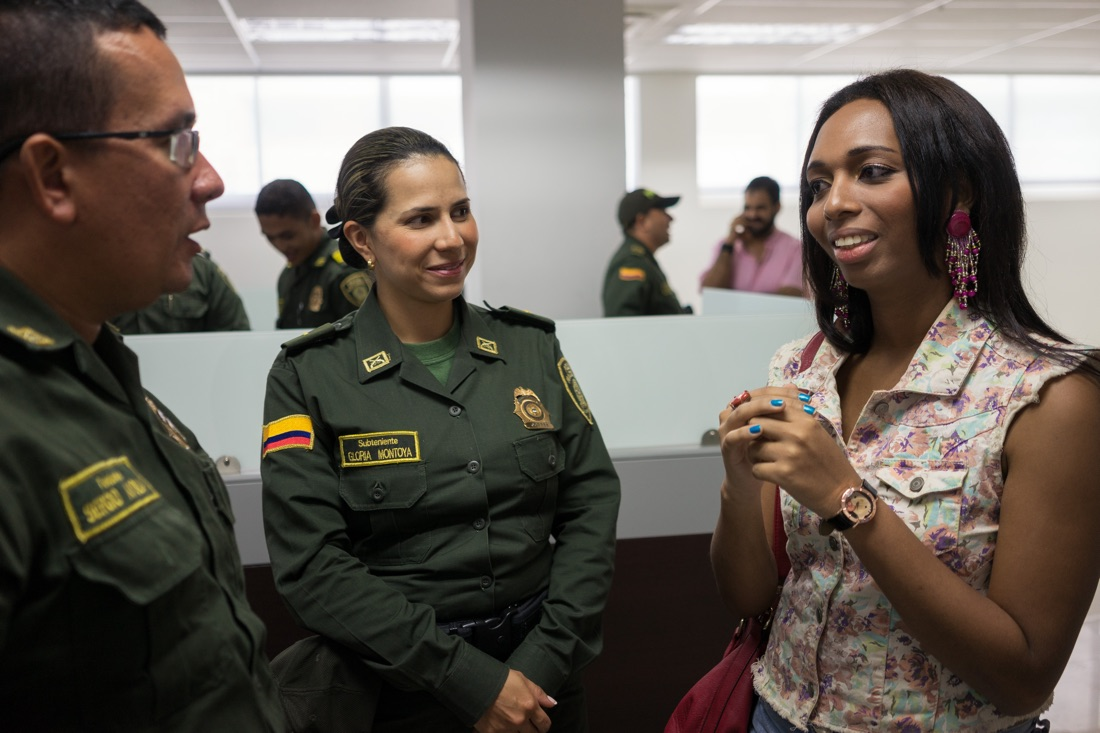 "CARTAGENA, COLOMBIA - FEBRUARY 25, 2015: Tania Duarte,  a student and trans activist for the group Caribe Afirmativo, talks with police officers in Cartagena on Colombia's Caribbean coast. With support from USAID, Caribe Afirmativo works with many sectors of society to try to improve the safety and well-being of members of the LGBT community, including improving their relationship with police. ""Before, being gay was a crime, a sin and a sickness,"" Duarte tells the police in a presentation where she explains the difference between sexual and gender identity. The trans community in Cartagena faces the most violence and persecution of any segment of the LGBT community. Of the 119 LGBT murders that Caribe Afirmativo has documented over the past seven years in Colombia's Caribbean region, more than two-thirds were of trans individuals. ""This is a racist and machista city,"" she explains. ""We are still seen as sick, socially maladjusted, and with psychological problems. And this goes hand in hand with the stereotype that we can only be prostitutes or hairdressers."" Caribe Afirmativo was founded in 2007 after the murder of the college professor and LGBT rights activist Rolando Peréz. The group documents cases of abuse against the LGBT population, trains law enforcement and policy officials on human rights, and fights so that those who commit crimes against this population are brought to justice. Throughout Latin America and the Caribbean and around the world, USAID works side by side with groups like Caribe Afirmativo to support human rights and dignity."