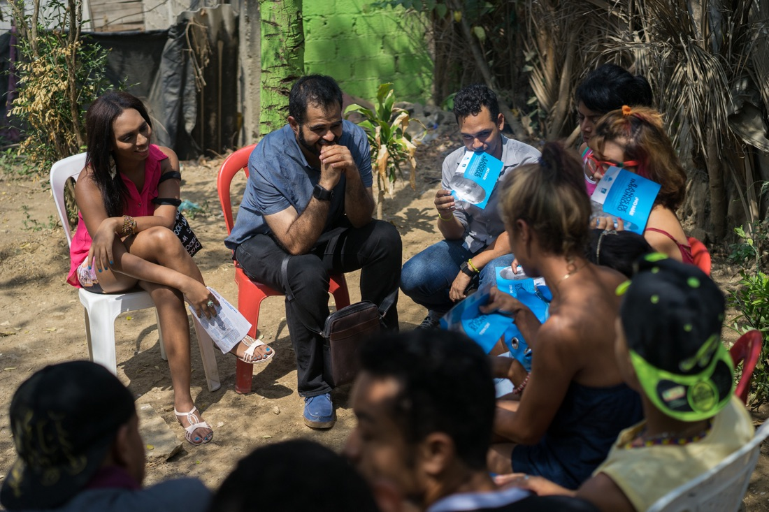 "CARTAGENA, COLOMBIA - FEBRUARY 26, 2015: Wilson Castañeda, director of the LGBT rights group Caribe Afirmativo, and the trans activist Tania Duarte meet with members of the trans community in a poor suburb of Cartagena, Colombia, where many of them live. ""Sometimes they are pelted with rocks, they are chased, they are stopped from using public transport,"" says Duarte, herself a 23-year-old transgendered person. ""There is drug trafficking, there are gangs. And because there is such a closed-mindedness and a patriarchal culture in this city, it's very hard for them to be in certain spaces where they want to be."" As part of her work with Caribe Afirmativo, Duarte helps educate other trans individuals about their rights, and provides support and services. The group also participates in public theater and acts to help sensitize the Cartagena community to issues of sexual diversity. As part of its work to improve the safety and well-being of LGBT members in Colombia's Caribbean region, Caribe Afirmativo also works hand-in-hand with local policymakers and officials, documenting violence, training law enforcement and other officials on human rights, and fighting so those who commit crimes against the LGBT population are brought to justice. Throughout Latin America and the Caribbean and around the world, USAID works side by side with groups like Caribe Afirmativo to support human rights and dignity."