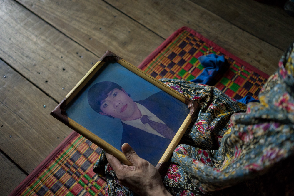 August 05, 2014 - Phnom Penh. Champa holds an old photo of her taken for an ID card. Aside from the general provisions in its Constitution, Cambodia has no laws specifically protecting or recognizing members of the LGBT community against discrimination or violence. The authorities also seem to have gone back on their promises to include lesbians and transgender women within the ambit of an action plan to stop gender-based violence.  © Thomas Cristofoletti / Ruom