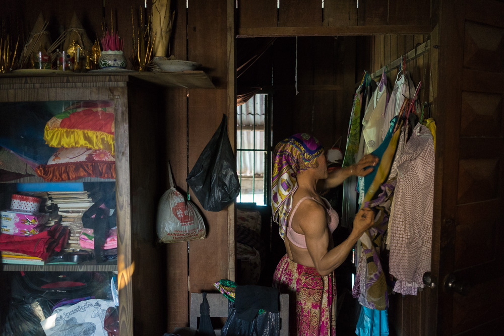March 22, 2014 - Phnom Penh. Champa gets ready to go out to work. She is the first openly transgender boxer in Cambodia. Because of the discrimination she endures as a transgender boxer, she was forced to quit her profession and became a sex worker. She now earns her living educating sex workers about their rights and occasionally turning to sex work herself. She was diagnosed with HIV twelve years ago. © Thomas Cristofoletti / Ruom