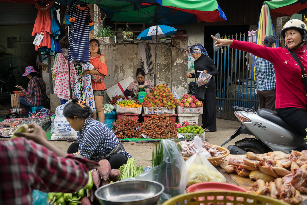 August 05, 2014 - Phnom Penh. Champa buys fruits in a market stall in front of her house. Champa is the first openly transgender boxer in Cambodia. Because of the discrimination she endures as a transgender boxer, she was forced to quit her profession and became a sex worker. She now earns her living educating sex workers about their rights and occasionally turning to sex work herself. She was diagnosed with HIV twelve years ago. © Thomas Cristofoletti / Ruom