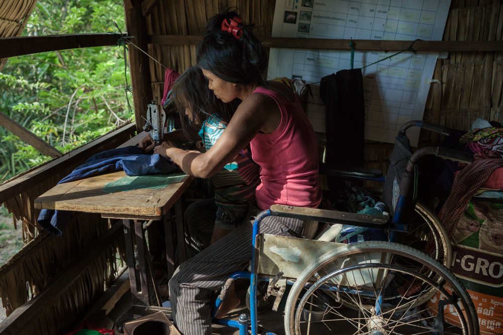 November 28, 2013 - Batheay village (Kompong Cham). Ms. So Yeou (50) received a tranining in sewing and she is now able to make some small incomes with this activity. She lost a leg when she stop on a landmine while she was working at her Bamboo farm. © Thomas Cristofoletti / Ruom for UNDP