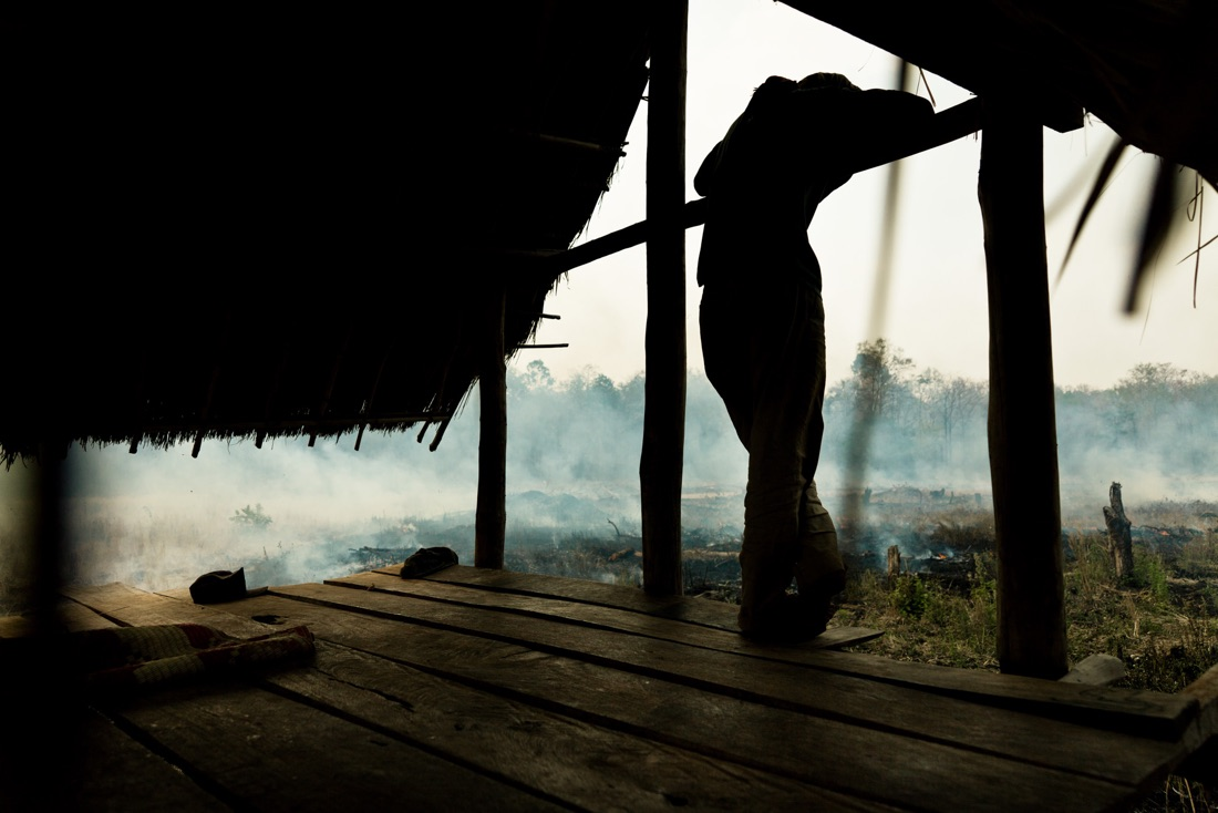 November 42, 2011 - Mondulkiri (Cambodia). A man controls the fire on his field. People in this village are indigenous but nowadays they seem to have lost most of their ancient traditions, as they have adopted many Western customs, such as the way they dress and, above all, the fact that they are now burning the forests that surround their village in order to plant potatoes and rubber trees. © Thomas Cristofoletti / Ruom