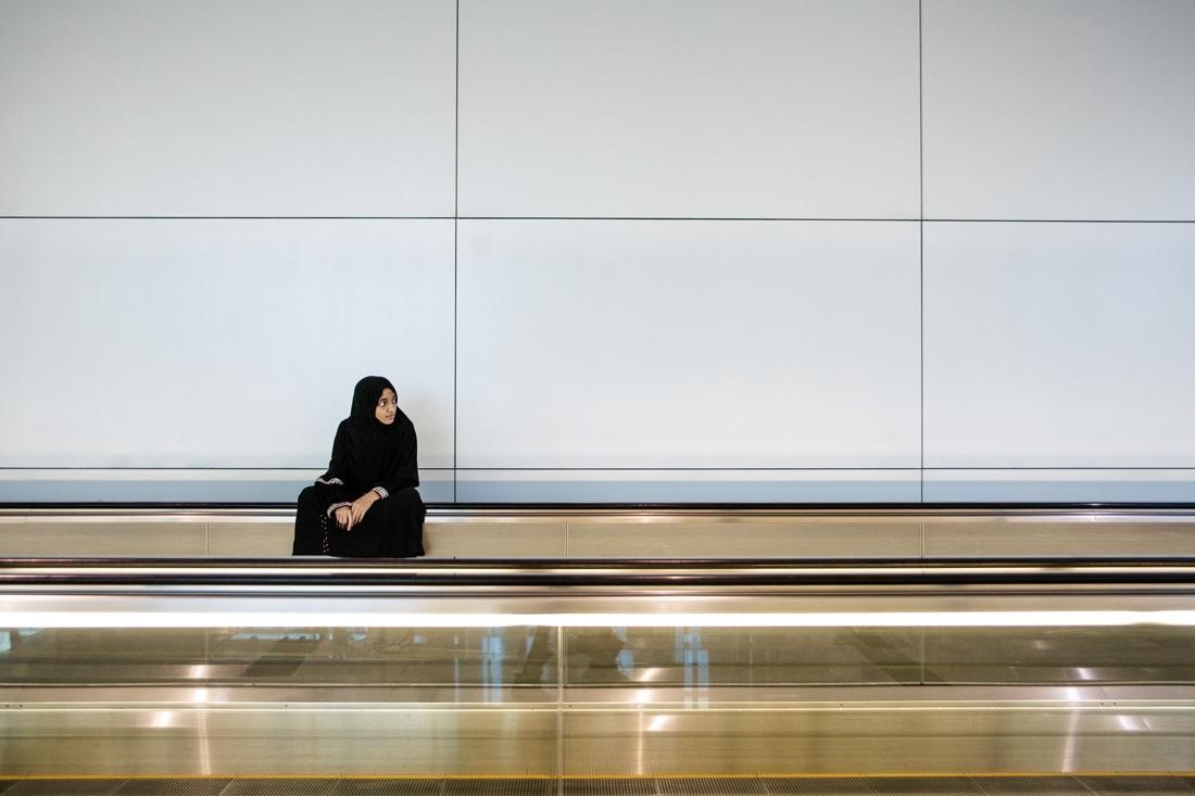July 3, 2012 - Dubai (UAE). A girl sits on a moving walkway inside Dubai's international airport. © Thomas Cristofoletti / Ruom