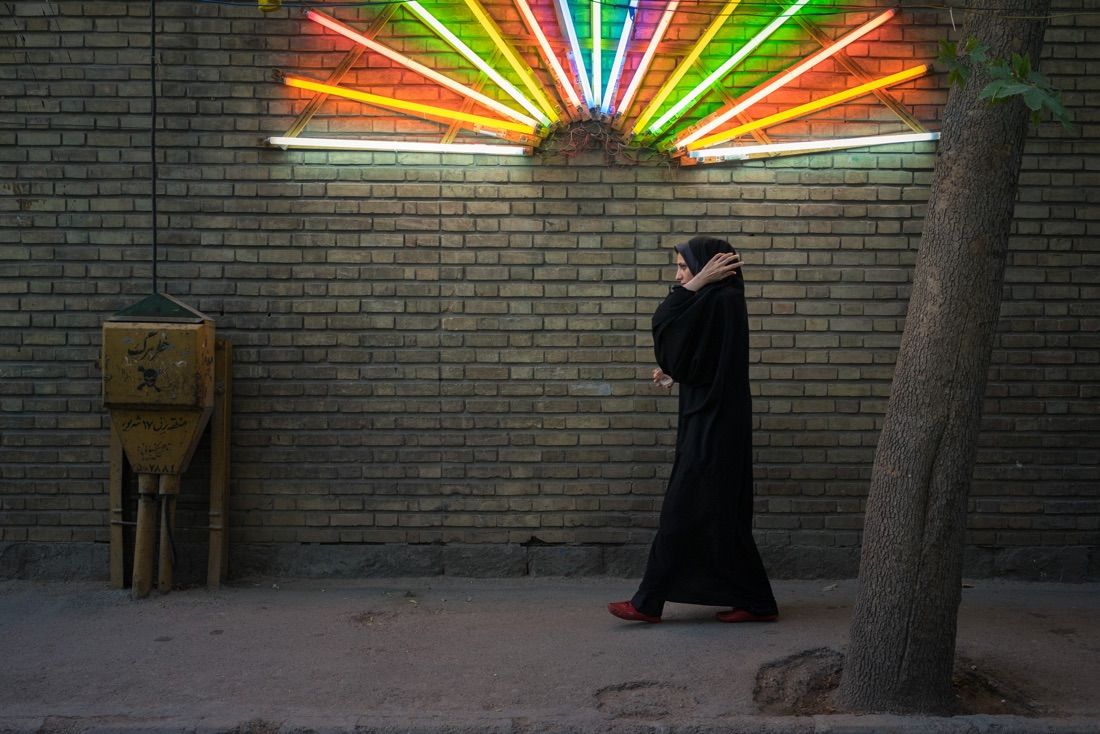 June 12, 2014 - Tehran (Iran). A woman walks in front of a light decoration installed to celebrate the birthday of Imam Mahdi. © Thomas Cristofoletti / Ruom