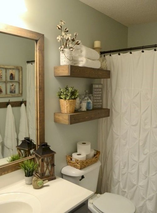 2. Stack it in the Bathroom - We bet that you have a crowded vanity in your bathroom, covered with hair and makeup products, dental hygiene necessities, and other miscellaneous items, like hair brushes and hand towels. We also bet that the huge, empty space above your toilet isn't being used. Ever think of this space as a place for storage? Head to the nearest hardware store to pick up some simple shelves to put up above your toilet, where you can now transfer all that clutter next to your sink onto this clever new area.Image credits: roundecor.com via Pinterest
