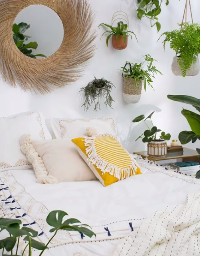 Plants Everywhere - An easy way to incorporate spring into your home is to place lots of greenery in the rooms of your home; put them on side tables, hang them from the walls, or anywhere else your heart desires! Like the look but don't want to commit to being a plant parent? That's okay - you can pick up fake plants at major stores like Target that'll look just like the real thing.Anthropologie Home