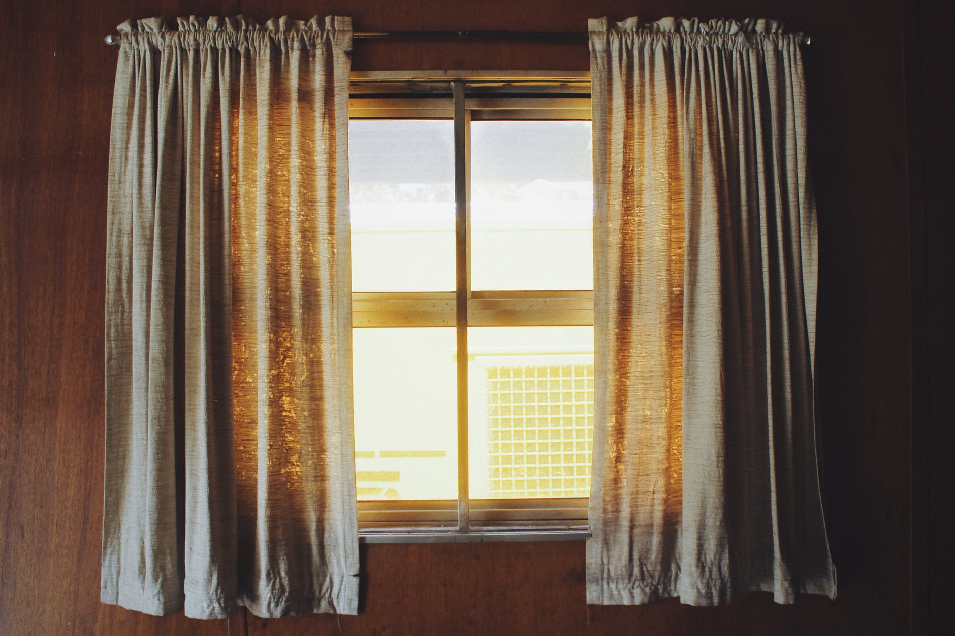 Bring in the Natural Light - There's no excuses not to take this tip- anyone with a window can do it! Simply opening the windows during the day will flood your home with natural light and a cool breeze. If you don't want to open a window, simply just open the shutters or the curtains for the same effect.