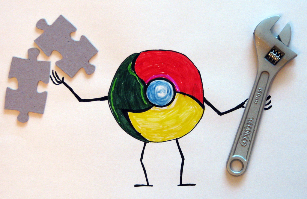 a drawing of the Chrome logo with arms and legs holds a wrench and two puzzle pieces