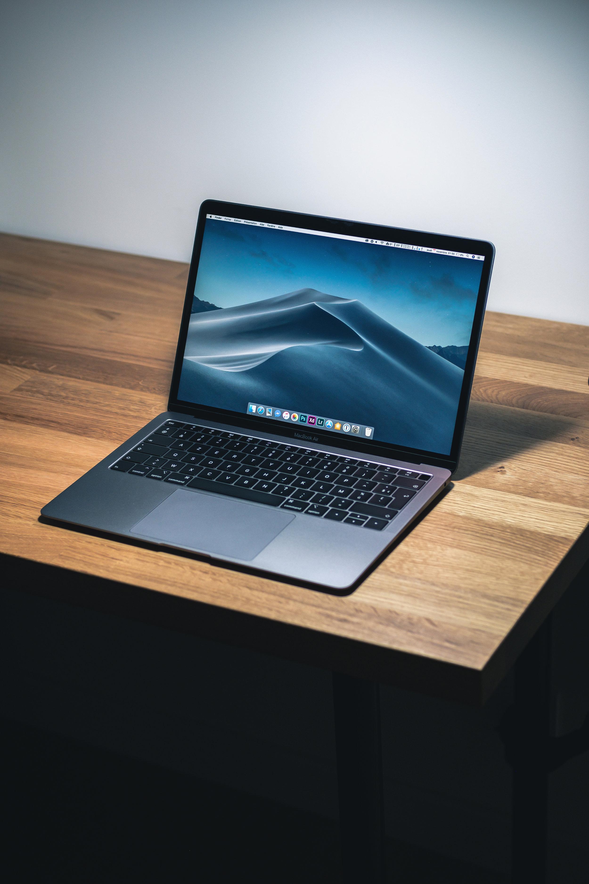 a black laptop sits on a desk