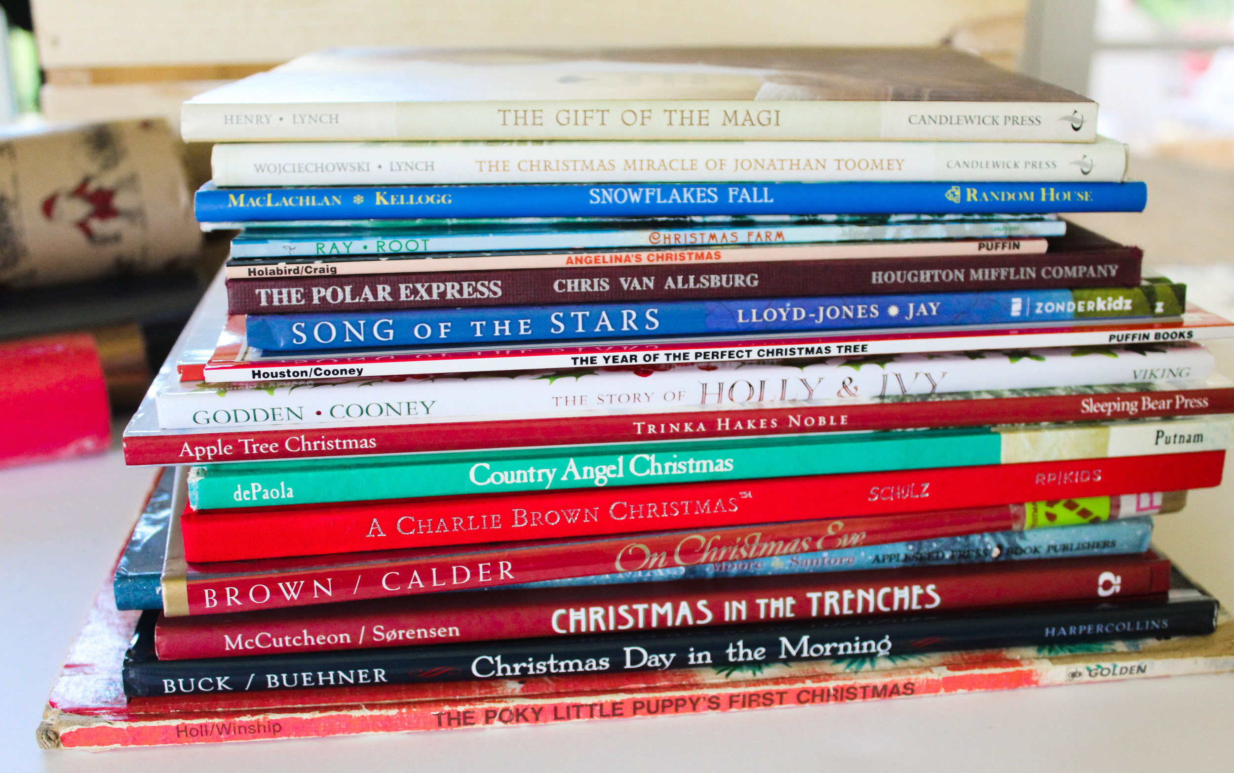 A few of our Favorite Advent books, stacked and ready to wrap.